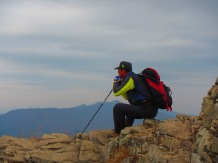 A hiker rests at the top.