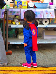 It was a superhero parade; she must have been all tuckered out because her own Dad-hero was indulgently getting her energy boosting ice cream.