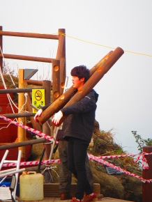Carrying logs up the volcano for early morning work