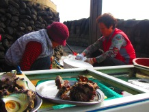 Divers slicing up some fresh seaslugs