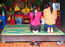 Praying in a makeshift temple